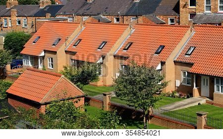 Elevated view of row of town houses in Scarborough, England.