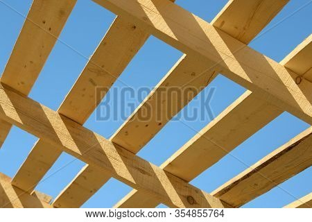Wood Board Assembled On Construction Site. New Frame Structure Of Building. Scaffolding Framework Ma