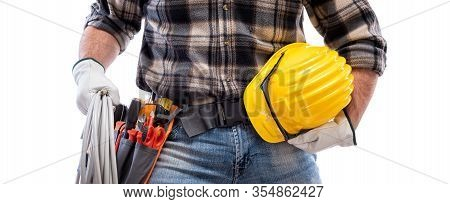 Electrician Holds The Roll Of Electric Cable In His Hand, Helmet With Protective Goggles. Constructi