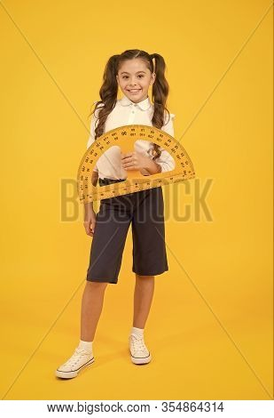 Mathematics Matters. Small Child Holding Protractor For Mathematics Lesson On Yellow Background. Cut