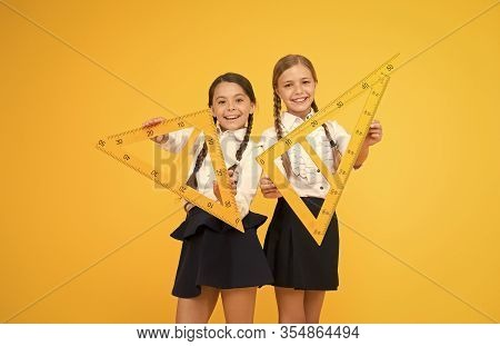 Pupil School Girls Big Rulers. School Knowledge. Explore World With Math. Mathematical Theory Combin