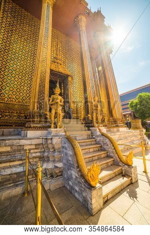 Temple Guardians And Staircase Outside Phra Mondop In Wat Phra Kaew Within Grand Palace Area In Brig