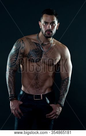 Jewelry For Real Men. Bearded Man With Tattooed Torso. Macho Sexy Bare Torso. Fit Model With Tattoo