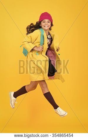 Tread On Air. Active Small Child Rush To School On Yellow Background. Happy Girl Enjoy Active Lifest
