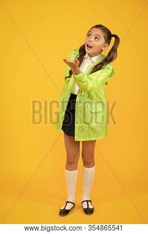 Schoolgirl In Green Cloak. Waterproof Accessory. Kid Girl Happy Wear Waterproof Cloak. Enjoy Fall We