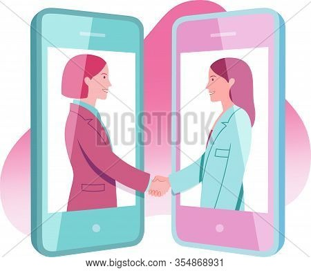 Two Young Business Women Working Remotely Agree Shaking Hands On The Screens Of Mobile Phones