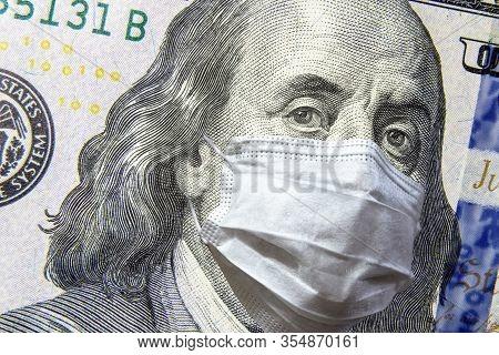 Covid-19 Coronavirus In Usa, 100 Dollar Money Bill With Face Mask. Covid-19 Affects Global Stock Mar