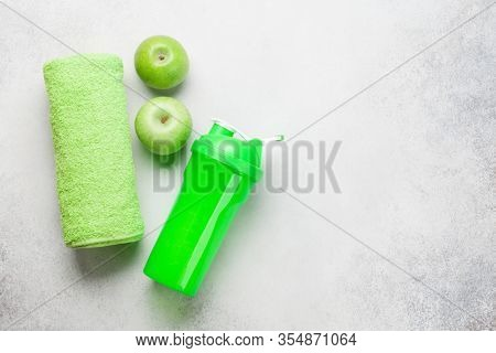 Fitness equipment and food on a stone background. Top view flat lay with copy space for workout plan