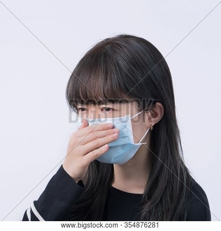 Woman Coughing With Mask - Young Asian Covering The Mouth, Feeling Unwell With Wearing Medical Blue