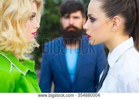 Infidelity And Jealousy Concept. Jealous Man Look At Lesbian Couple In Love On Street