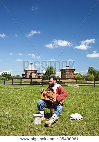 Man playing on psaltery