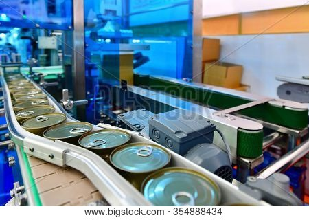 Canned Food Products On Conveyor Belt In Distribution Warehouse.parcels Transportation System Concep