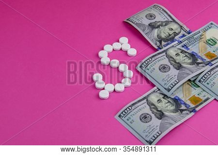 Prescription Drugs On A Money Background Representing Rising Healthcare Costs.