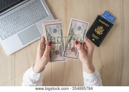 Time Lapse. Woman Hold Banknote 50 U.s. Dollars In Hand And Count It. American Passport With Boardin