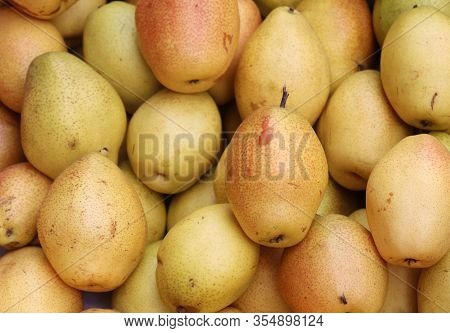 Fresh Pears As Background. Healthy Pear Fruit In A Shop, Top View