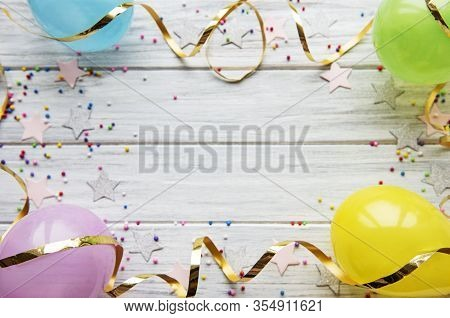 Happy Birthday Or Party Background.  Flat Lay Wtih Birthday Hats, Confetti And Ribbons On White Wood