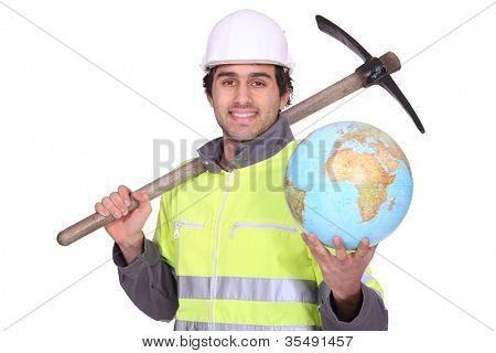 Construction worker holding a glove and pickaxe