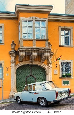 Budapest, Hungary, Aug 2019, View Of A Trabant Car Parked In Front Of A Ochre Color Building