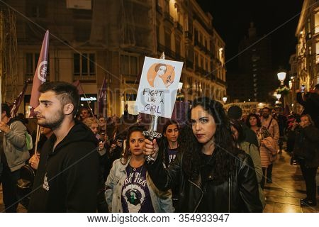 Malaga, Spain - March 8 Th, 2020: People Celebrating 8m Woman Day With Banners And Placards, During