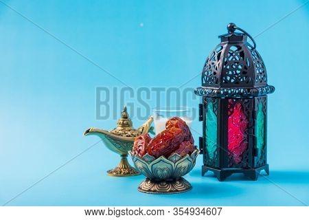 Ramadan Kareem Fasting Food Concept, Bronze Plate Dates, Milk, And Lantern Aladdin Lamp Decoration,