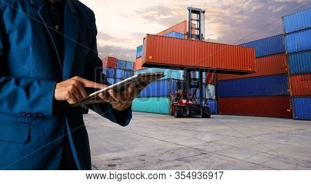 Businessman Manager Touching Tablet Check And Control For Workers With Container, Working Crane For