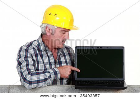 Tradesman pointing to his new laptop