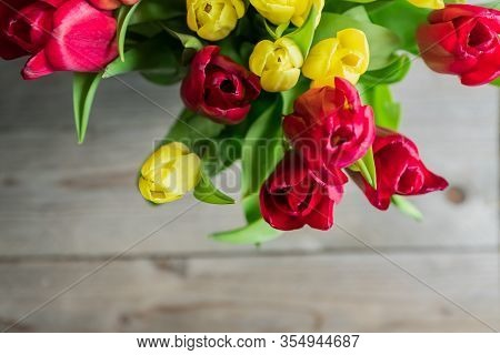 Top View Of Bouquet Of Red And Yelow Tulips . Floral Background. Festive Greeting Card For Mothers D