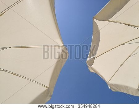 Wide Angle View Of Beach Umbrellas Close Up Sunny Day