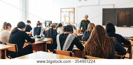 A Classroom, A Lecture, A Lesson Is Going On, Students Are Listening To The Teacher, The Teacher Tal