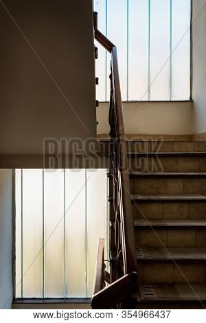 Wooden Staircase With Handrailing In An Old House. Interior Decor Of Old Stairs. Old House Design De