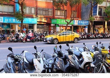 Taipei, Taiwan - December 5, 2018: Scooter Parking In Xinyi District Of Taipei, Taiwan. Taipei Is Th