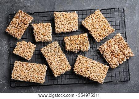 Delicious Rice Crispy Treats On Grey Table, Flat Lay