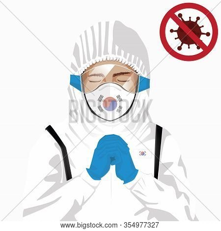 Covid-19 Or Coronavirus Concept. Korean Medical Staff Wearing Mask In Protective Clothing And Prayin