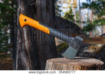 Tourist Ax On A Stump In A Summer Forest. Chopping Wood With An Ax. Tourist Camping. Summer Day. The