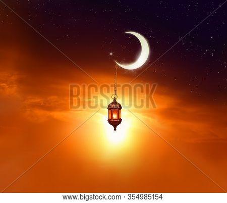 Ramadan Kareem background.Crescent Moon and Lantern Lightning in sky