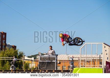 Kremenchug, Ukraine - June 5, 2017:  Extreme Bmx Rider In Helmet In Skatepark On Competition. Uniden