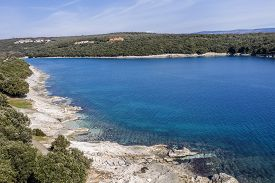 An Aerial View Of Beautiful Beach And Clear Calm Sea In Duga Uvala, Istria, Croatia