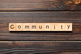 Community Word Written On Wood Block. Community Text On Wooden Table For Your Desing, Top View Conce