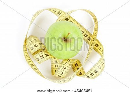 Green Apple And Measuring Tape Isolated On White Background