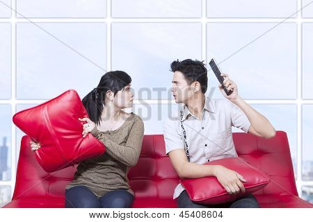 Couple Fight On Red Sofa - Indoor