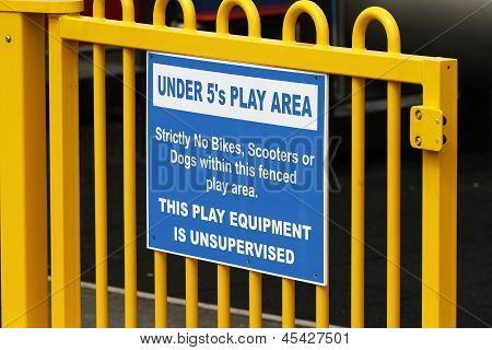 Warning sign on play area.
