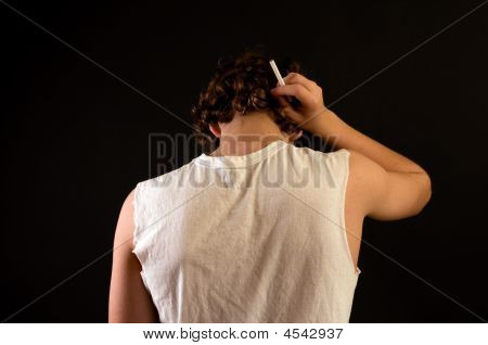 Teen Boy With Cigarette, Rear View