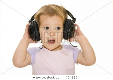 Surprised Funny Baby With Headphones.