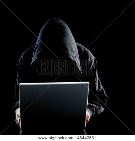 Computer hacker on black background, identity theft concept poster