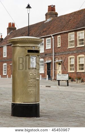HAMBLE, NR SOUTHAMPTON, UK - AUG 8 : UK's Royal Mail honours Olympic Gold Medal winners, by transforming a post box from red to gold in the home town of each gold medallist. 8 Aug 2012