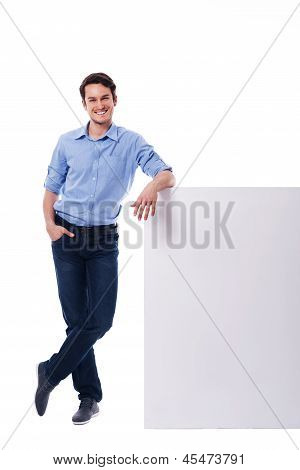 Young man leaning on the empty board