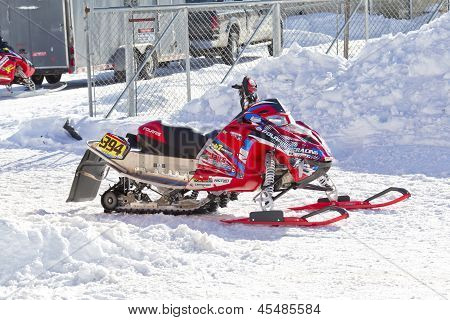 Red And Black Polaris Snowmobiel After The Race