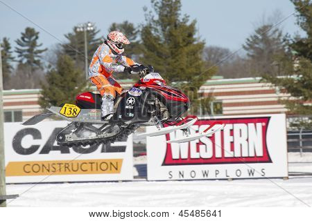 Red And Black Polaris Snowmobile Soaring