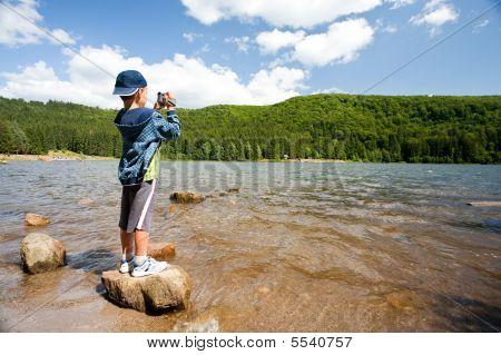 Boy Using Video Camera Outdoors