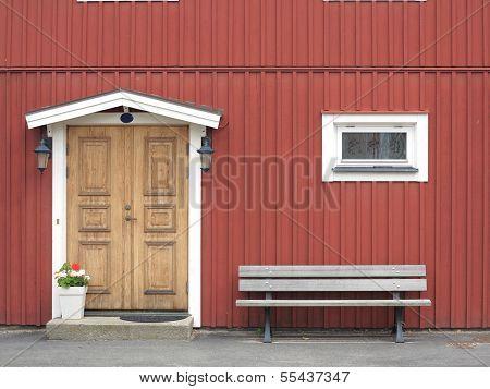 Wooden Yellow Door In Red Colored Building
